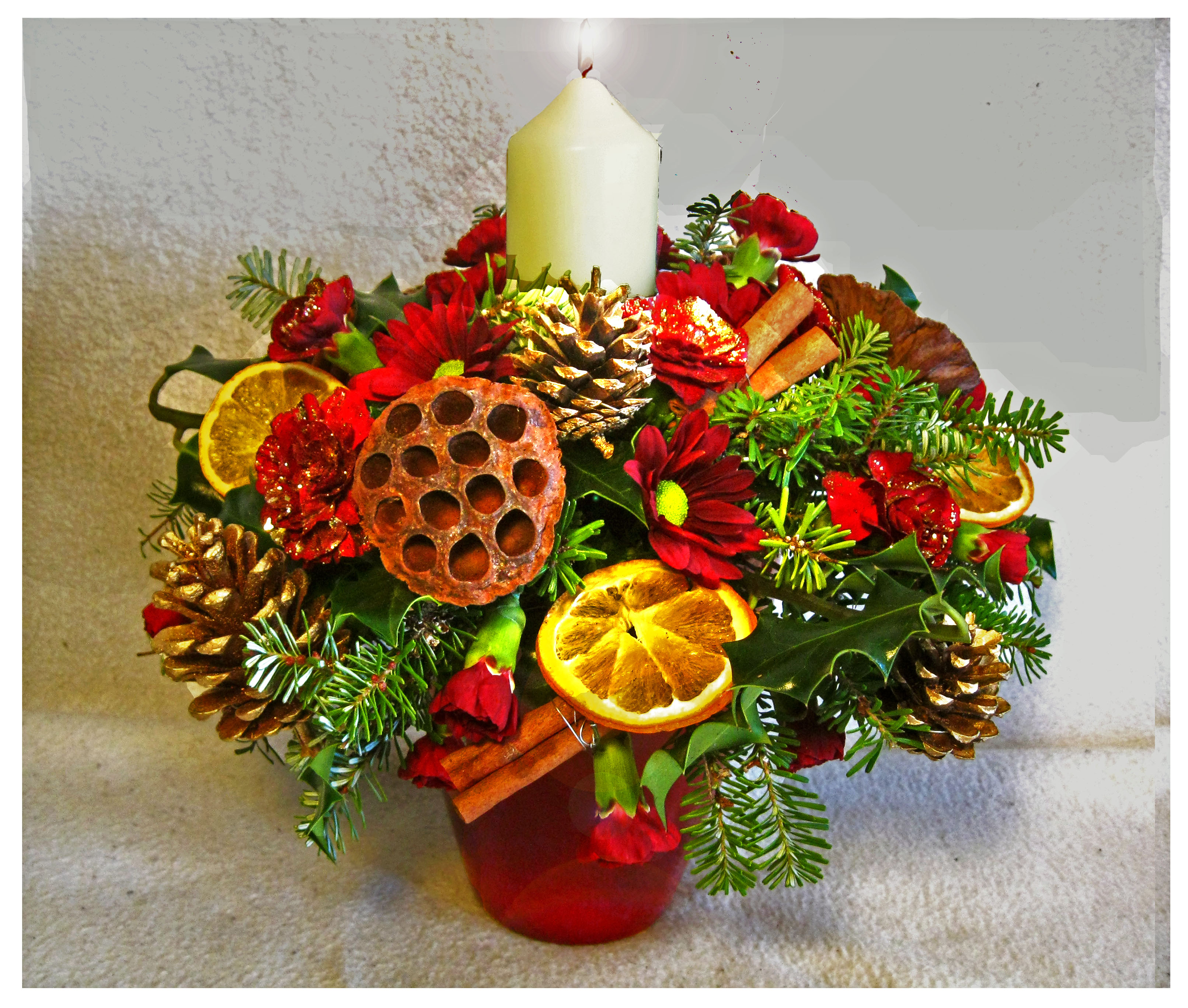 Christmas candle arrangement leeds flower delivery