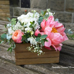 wooden box of flowers coral centrepiece table wedding flowers leeds