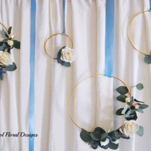 4-hanging-gold-rings-of-fresh-flowers-backdrop-stage