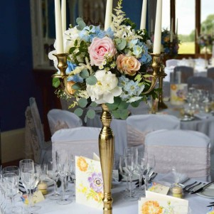 allerton castle wedding centerpiece gold candleabra pastel flowers