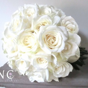 avalanche rose bouquet, compact ivory roses, wedding flowers, bridal bouquet, wedding florist leeds, west yorkshire