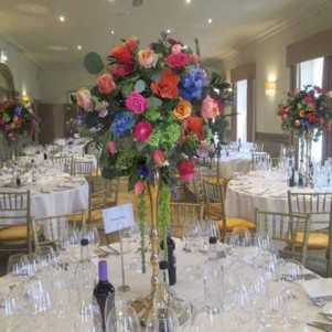 gold candelabra centerpiece, the mansion roundhay, bright colours, pink, bue, orange