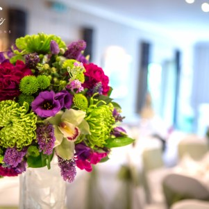 green, purple, magenta, wedding flowers, vibrant tall centerpiece, weddings, ball of flowers