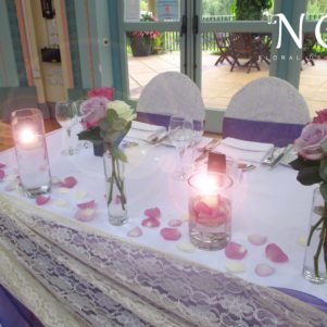 lilac and purple flowers, top table, candles floating