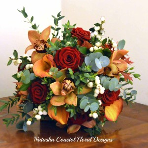 orchid calla, red rose, orange autumnal berries