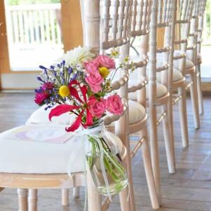 pew end jars flowers colourful bright modern yorkshire wedding