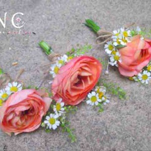 ranunculus coral and daisy buttonhole