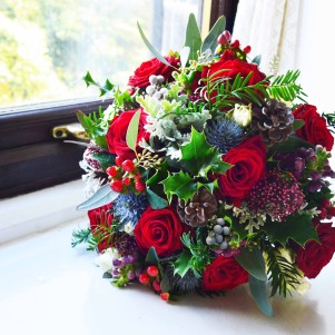 red christmas wedding flowers claret, berries pine cones thistle copy
