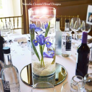 submerged flowers in water vase centerpiece