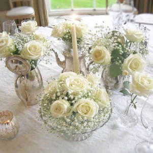 tea pots gy and whiet rose centerpiece