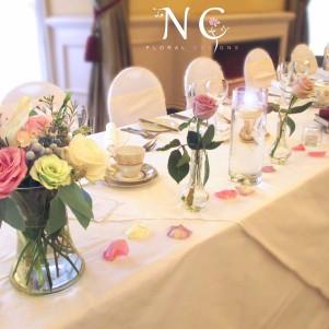 the crown harrogate wedding flowers top table vase candles