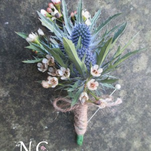 thistle and wax flower rustic buttonhole