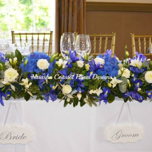 top table blue iris blue hdyrangea white flowers