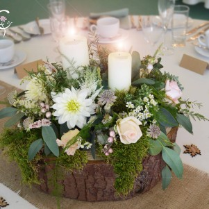 woodland centerpiece moss log base pastel flowers